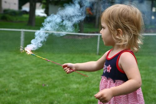Shh, Don't Tell Grandma, But the Baby Had Sparklers Too (And Loved Them)